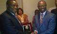 Health Minister, Prof. C. O. Onyebuchi Chukwu  receiving a plaque from Falcon Augustine Okereke