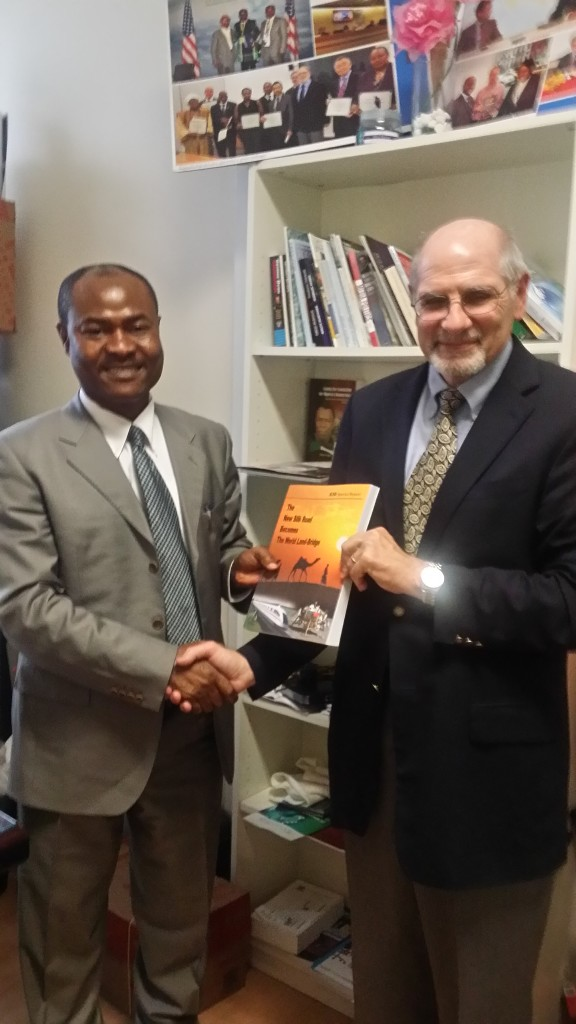 Lawrence Freeman makes a presentation of a copy of EIR special publication to Dr. Uchenna Ekwo of CMPI