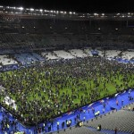 Spectators gather on the pitch of the Stade de France stadium following the friendly football match between France and Germany in Saint-Denis, north of Paris, on November 13, 2015, after a series of gun attacks occurred across Paris as well as explosions outside the national stadium where France was hosting Germany. At least 18 people were killed, with at least 15 people had been killed at the Bataclan concert hall in central Paris, only around 200 metres from the former offices of Charlie Hebdo which were attacked by jihadists in January.  AFP PHOTO / FRANCK FIFEFRANCK FIFE/AFP/Getty Images